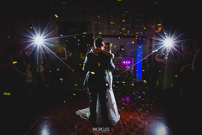 first dance and the confetti cannon has been fired providing an amazing effect